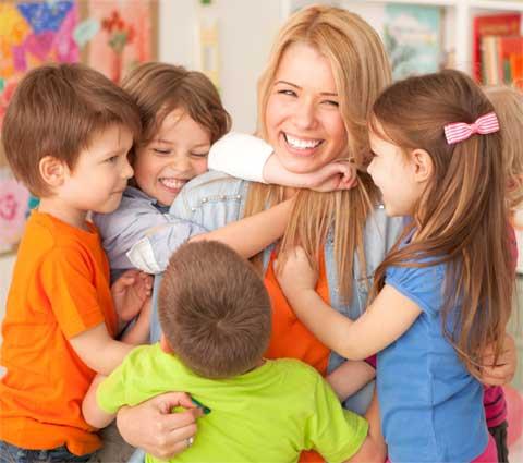 teacher-hugging-kids